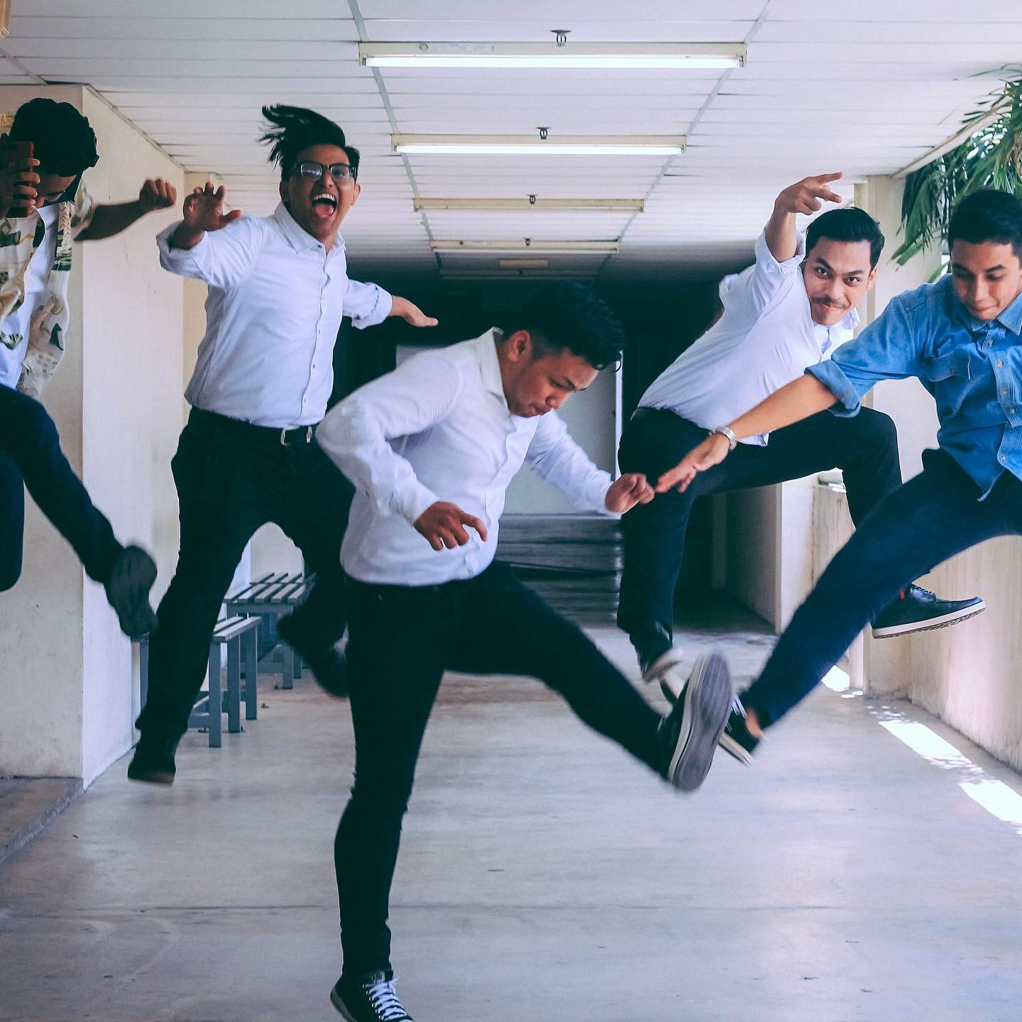 Happy students leaping in the air