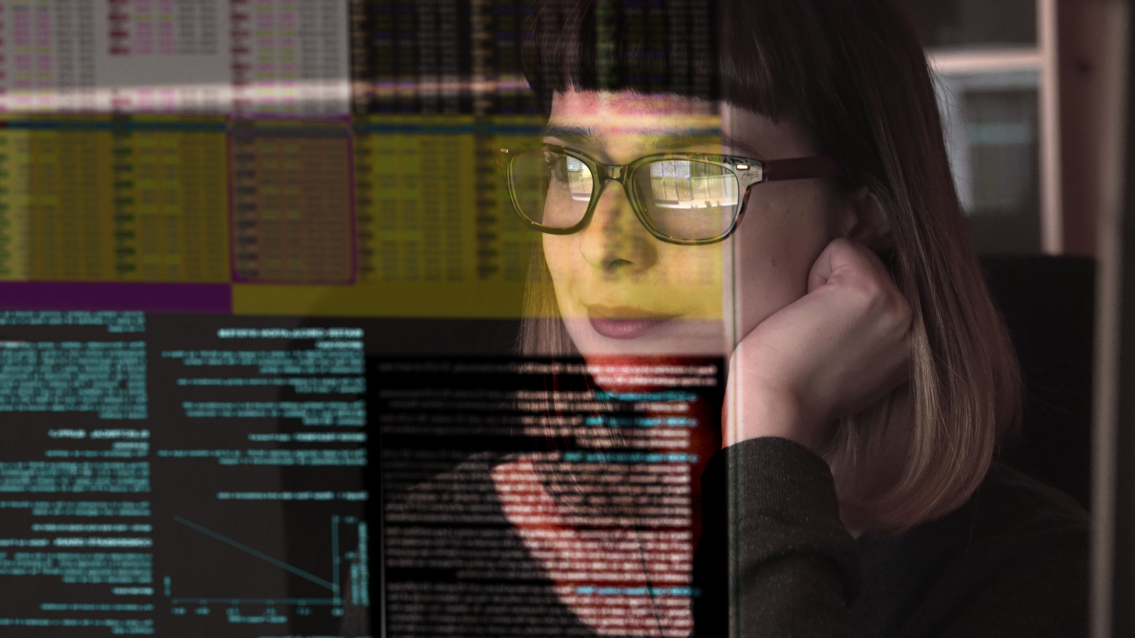 Lady with glasses looking at computer screen