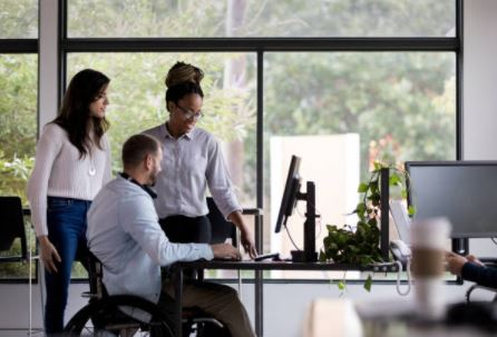 Three people working together in an office