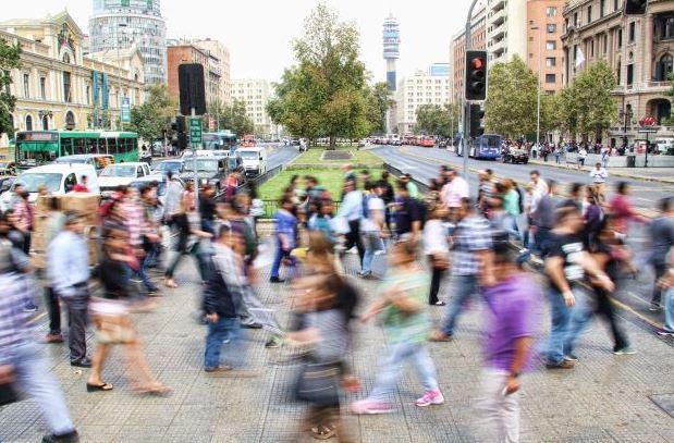 Blurred people crossing street